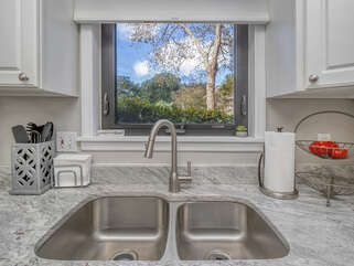 Beautiful renovated kitchen with stainless appliances.  Also a window with a view.