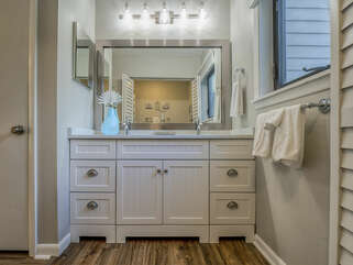 The master bath has laminate floors and granite counter top with double sinks.