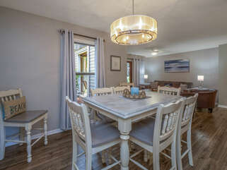 The open floor plan has plenty of space for dining or playing games.
