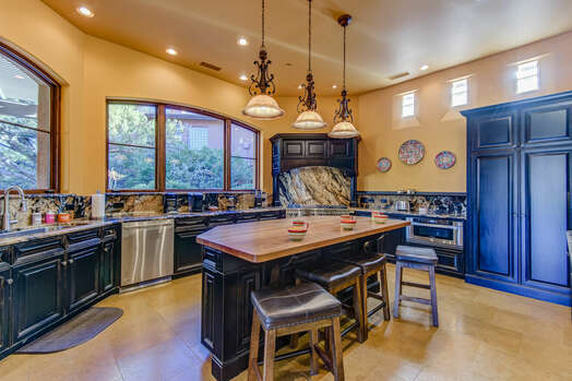 Gourmet Kitchen with a Butcher Block Island and Wine Fridge