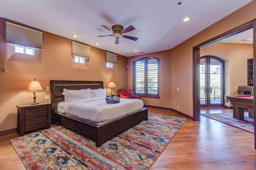 Main Level Grand Master Bedroom with a King Bed and Access to the Billiards Room