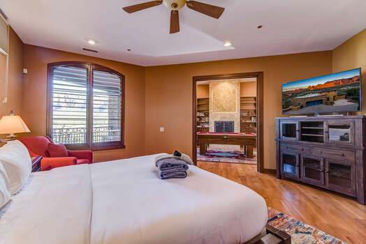 Grand Master Bedroom with a King Bed and 55