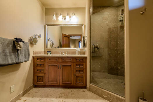 Master Bath 2 with a Stone Counter Vanity and Tile/Glass Shower