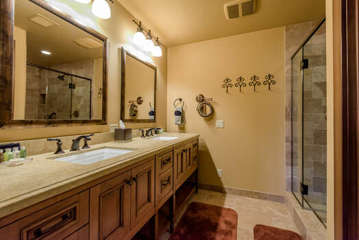 Full Shared Bath 3 with Dual Stone Counter Sinks and a Tile/Glass Shower