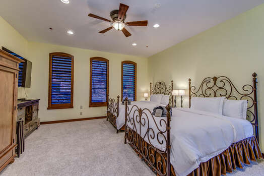 Bedroom 3 with Two Queen Beds and Access to a Full Shared Bath