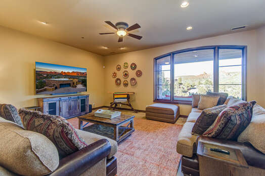 Lower Level Family Room with Comfortable Seating, an 85