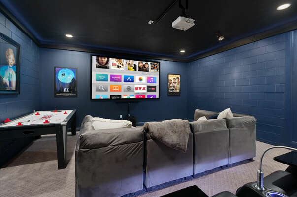 Get comfortable on the large couch seating or choose one of the 3 theater-style seats