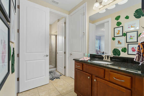 Attached Jack and Jill bathroom connected to the second kid's bedroom
