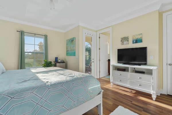 This bedroom features a king-size bed and SMART TV