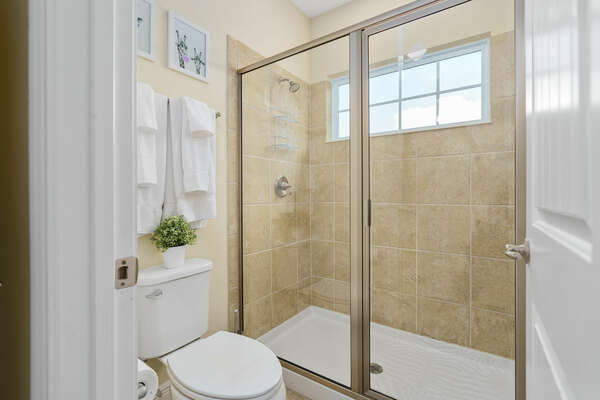 Featuring a walk-in shower
