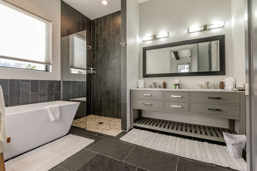 Master Bath 1 with Dual Stone Counter Sinks, a Soaking Tub and Tile Shower