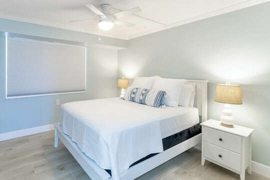 Guest bedroom with a king sized bed.