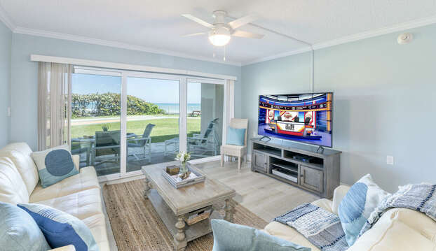 Walk right out to the ocean! Enjoy views of the ocean or your big screen TV right from your living room.