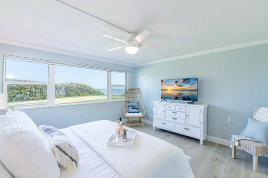 Enjoy the beautiful ocean view from your bed. There is also a big screen TV for your enjoyment.