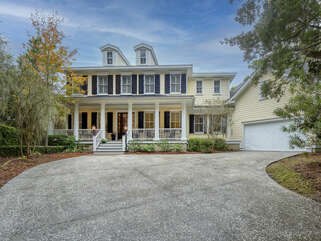 Lovely low country home is built into an early dune line giving you a private setting. This home on the inside has beautiful hardwood floors and an open floor plan.