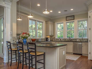 Beautiful updated kitchen with stainless appliances. Granite counter top and hard wood floors