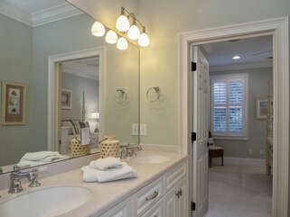 3rd and 4th bedrooms share a Jack and Jill bathroom with double sinks.