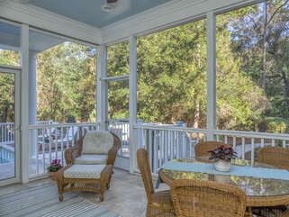Screened in porch for outdoor living and dining.