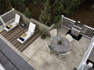 Deck/patio with seating and a gas grille