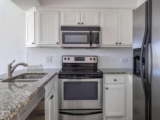 Stainless steel appliances, shaker cabinets and granite counter tops.