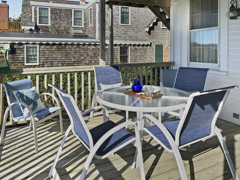 Deck table and 6 chairs for outdoor activities.  323 Main Street Chatham Cape Cod - New England Vacation Rentals