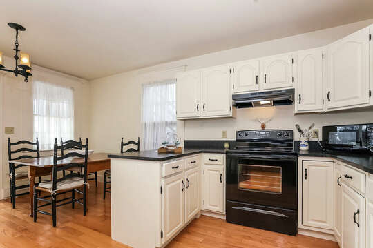 Open concept kitchen to help keep the conversation going.  323 Main Street Chatham Cape Cod - New England Vacation Rentals
