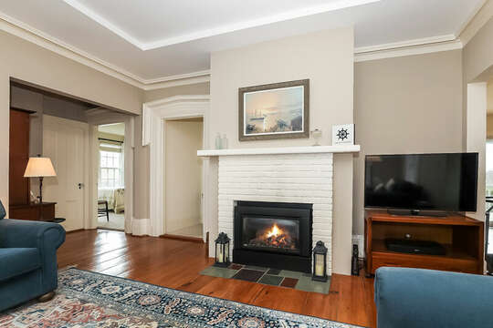 Gas fireplace for chilly nights and TV for all to watch.  323 Main Street Chatham Cape Cod - New England Vacation Rentals