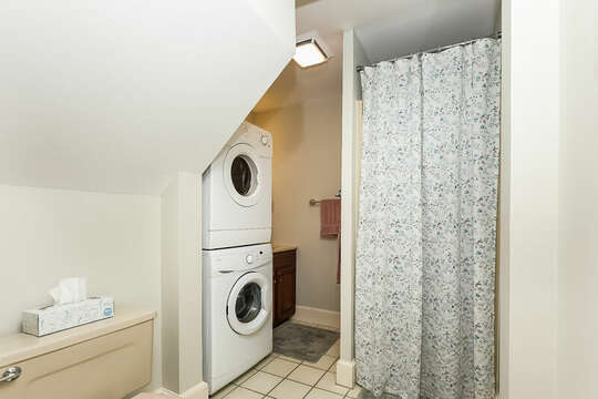 Full bathroom in hallway with stackable washer and dryer. 323 Main Street Chatham Cape Cod - New England Vacation Rentals