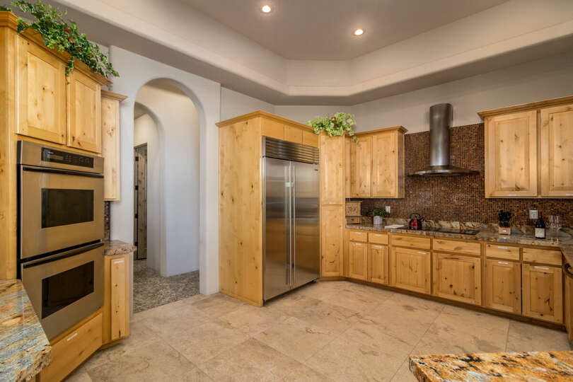View of the fridge in kitchen