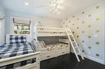 The second bedroom is super cute for the kiddos and has plenty of space to play.