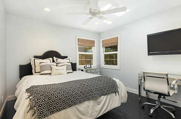 The master bedroom offers a comfortable king size bed and a 55 inch flat screen Smart TV.