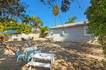 The Oceanside Palms Beach Bungalow has a very large yard, plenty of space for kids to run around and play.