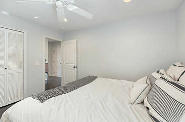 The master bedroom has a decent size closet and ceiling fan.