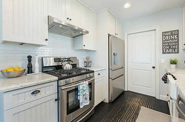This light and bright kitchen has stainless steel appliances throughout.