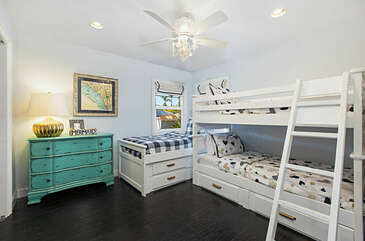The second bedroom has three twin beds.