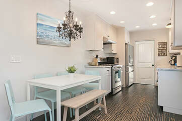 Dining and kitchen space all flow together.