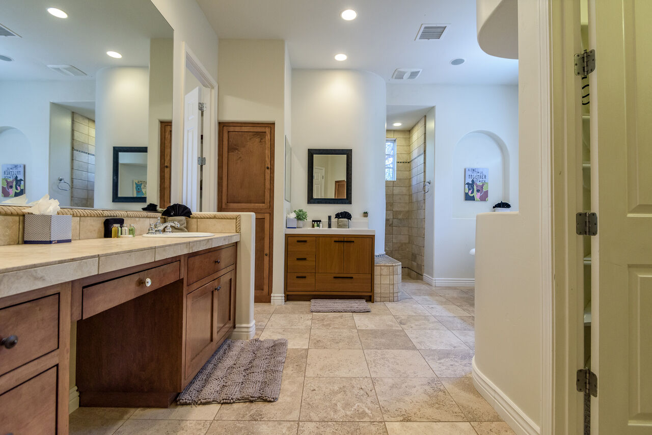 Master Bath with a Walk-in Closet and Tile Shower