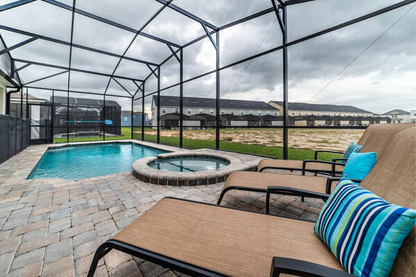 The pool deck is screened in and offers plenty of lounger seating for your guests