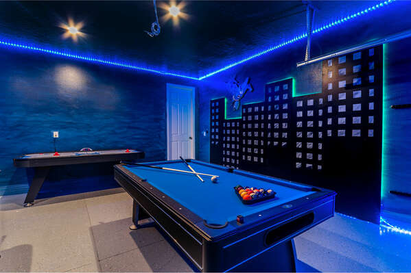 The LED-lit game room features a pool table and air hockey table