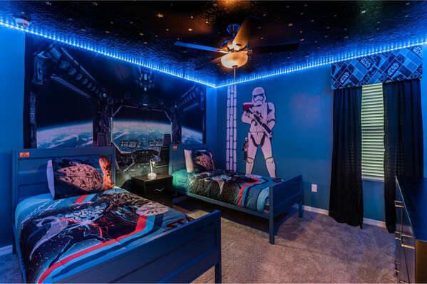 The galaxy-inspired kids bedroom features LED-lighting and the little ones favorite characters