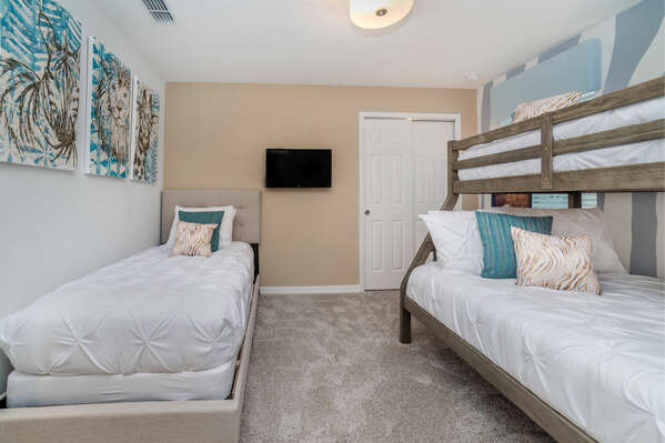 The kids bedroom offers three comfortable beds