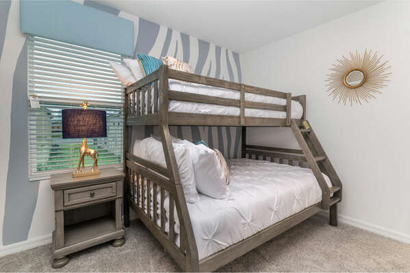 The little ones can choose between the bottom bunk or the top of this full/twin bunk bed