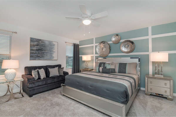 The master suite offers a king-sized bed with a comfy couch to lounge at