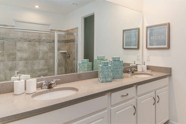 This double vanity bathroom has plenty of space to get ready in the mornings
