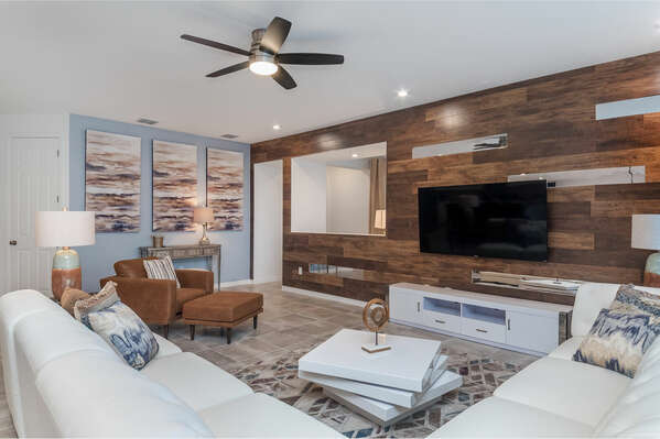 The living area offers ample seating for the family