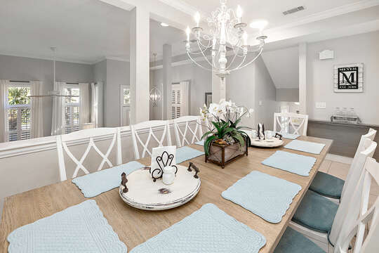 Dining room with seating for 10 plus extra fold out table with seating for 2