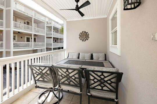 Rear porch off ot the kitchen with dining area for 6 and an addtional sitting area