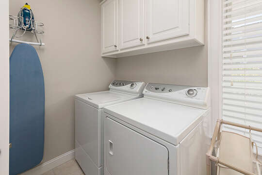Laundry Room with washer/dryer and a laundry sink