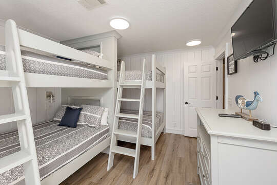 Bunk Room with Four Full Size Bunk Beds and an HD TV