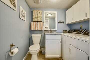 Half bath/laundry room, adjacent to kitchen.